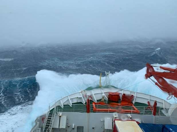 Ship battling high waves