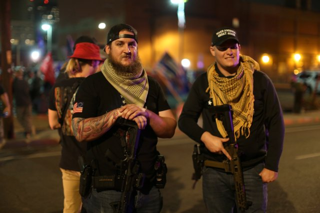 Two armed Trump supporters.