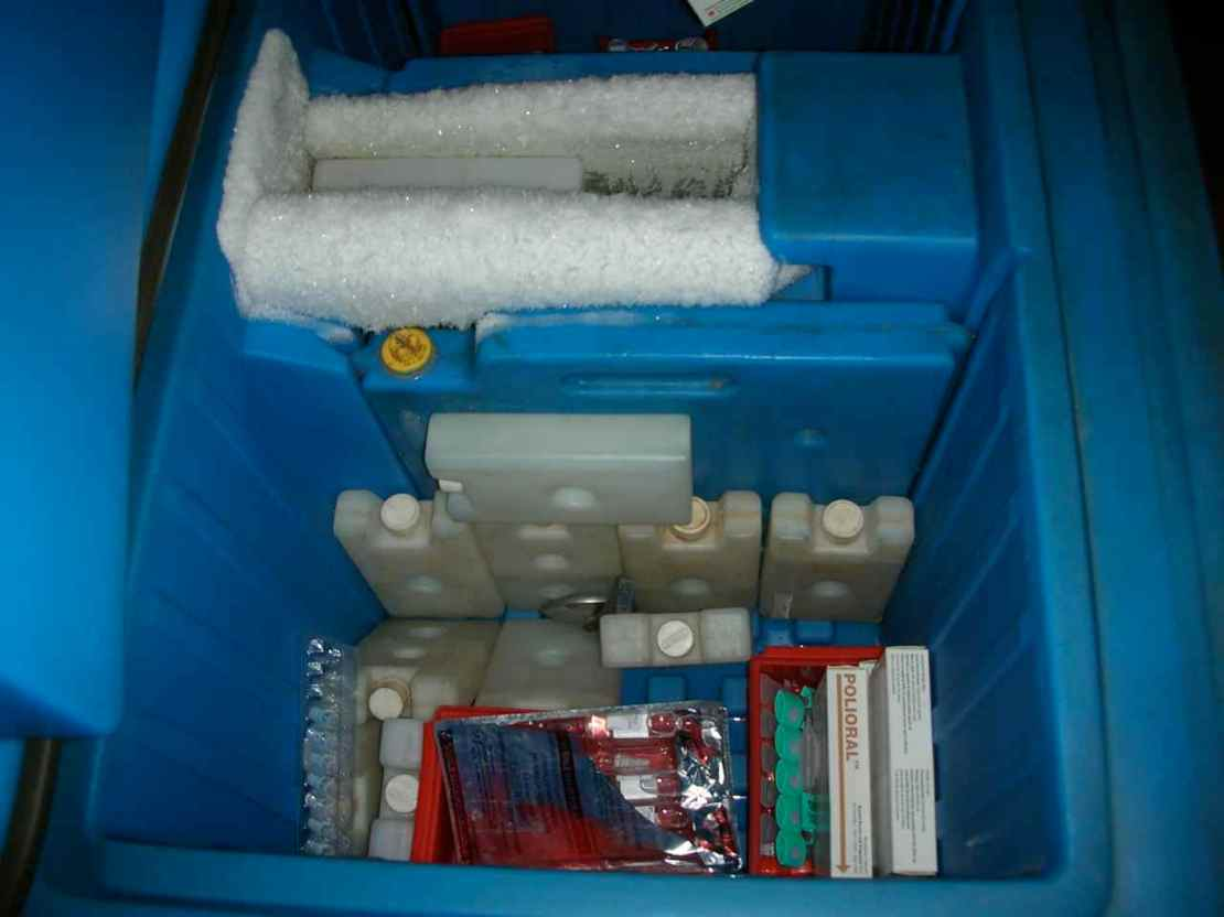 Cold chain being maintained using ice box while transporting polio vaccine