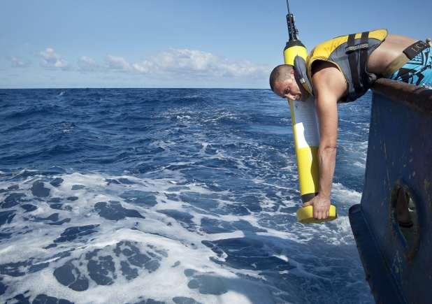 Marine scientist deploying an ocean probe