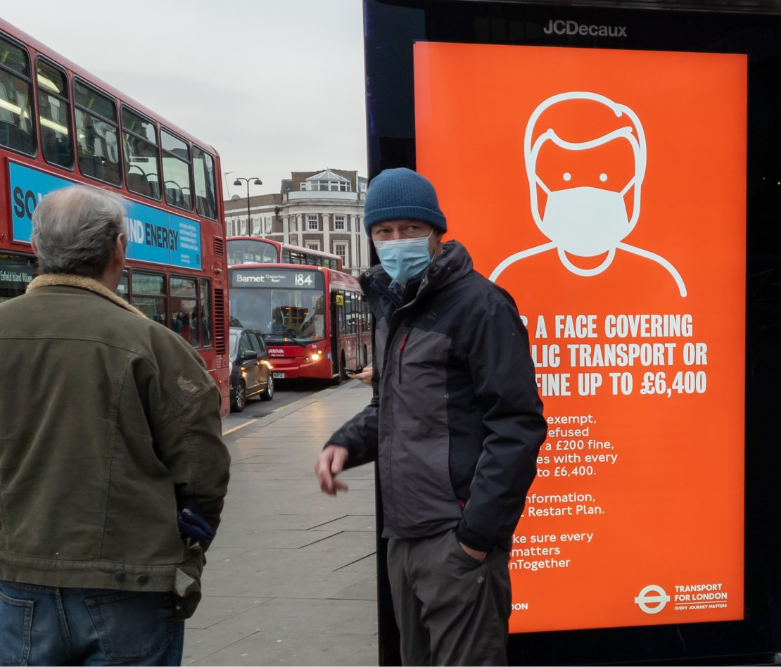 A public health advert in London, stating that not wearing a mask on public transport could lead to a £6,400 fine