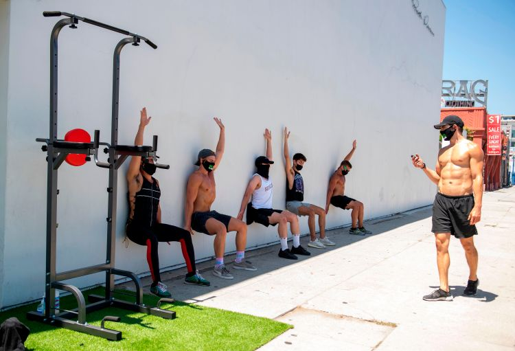 people working out outdoors with instructor
