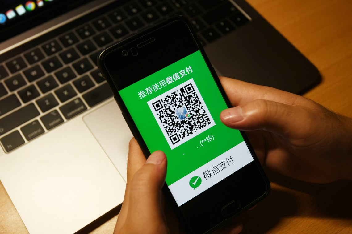 Consumer using WeChat Pay on their phone