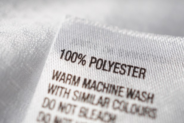 A clothing tag saying 100 per cent polyester