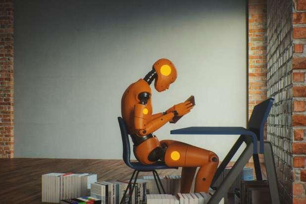 روبوت إنسان يقرأ كتاباً