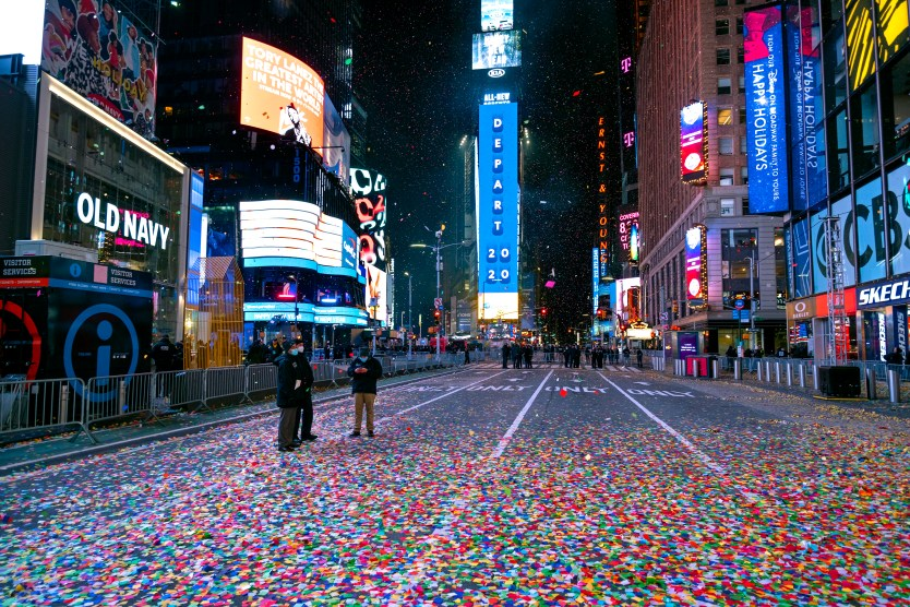 Times Square in New York City is nearly empty on Jan. 1, just after midnight, as celebratory confetti covers the street.