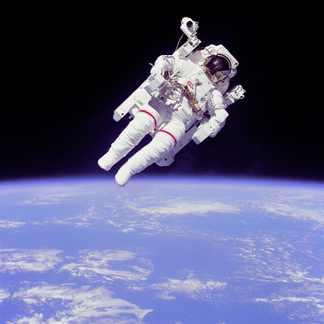 Astronaut with Earth in the background.