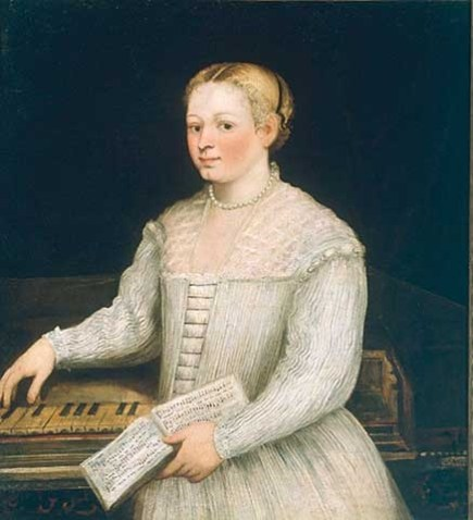 A woman stands looking at the viewer, her hand draped over a piano.