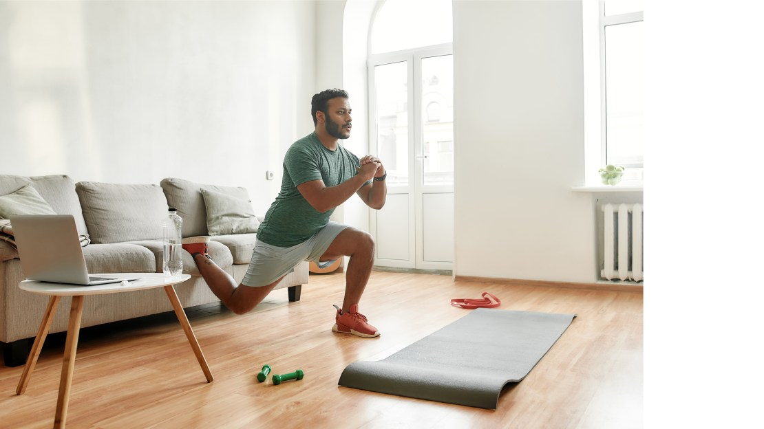 A man doing exercises in his living room