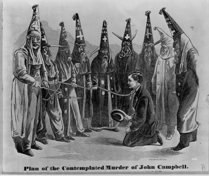 An 1871 engraving depicts a group of Klansmen surrounding a man on his knees with a rope around his neck.