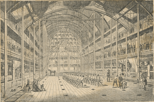 People exercise in the high-ceilinged gymnasium.