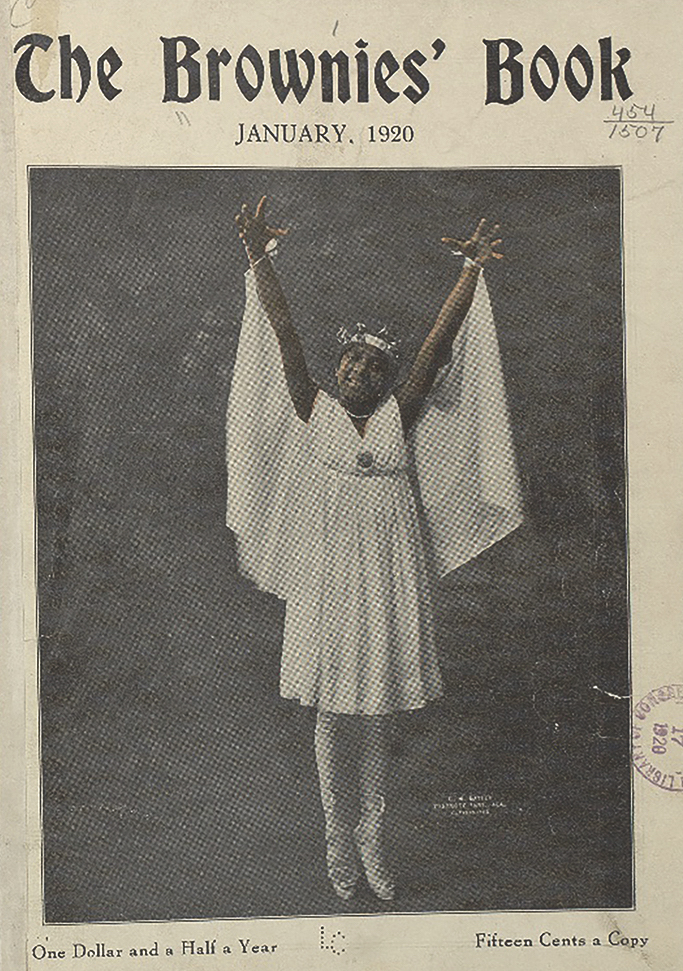 A smiling girl dressed in white raises her arms and stands en pointe.