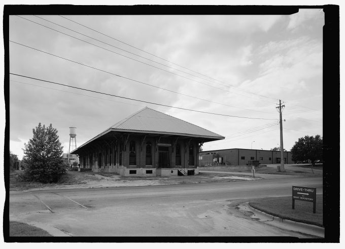 Black and white image of an old train depot