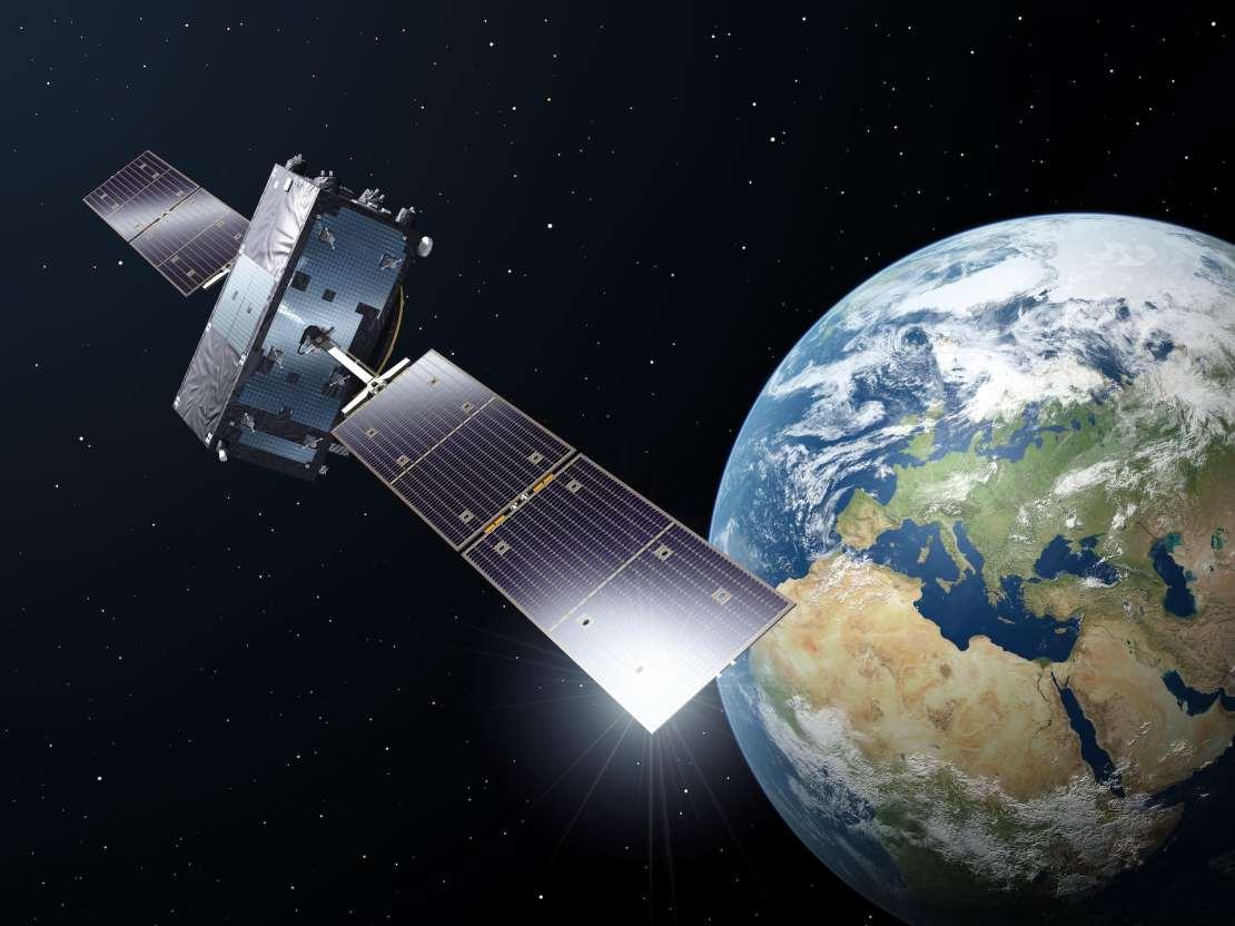 Galileo satellite in orbit, Earth in the background.