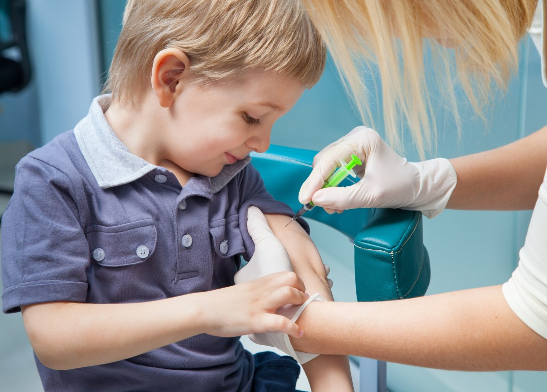 A young boy being vaccinated