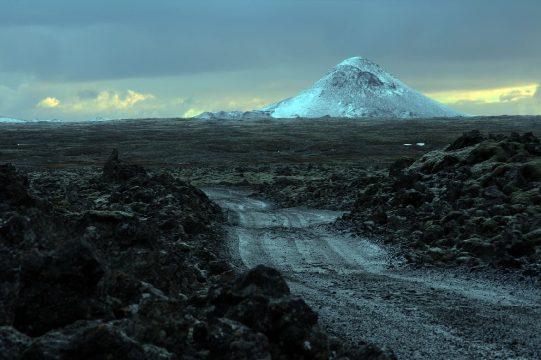 A dramatic image of the snow-covered volcano Mt Keilir just south of Reykjavik in Iceland.