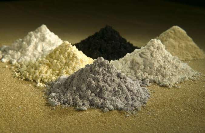 Piles of rare earth elements, clockwise from top center: praseodymium, cerium, lanthanum, neodymium, samarium and gadolinium