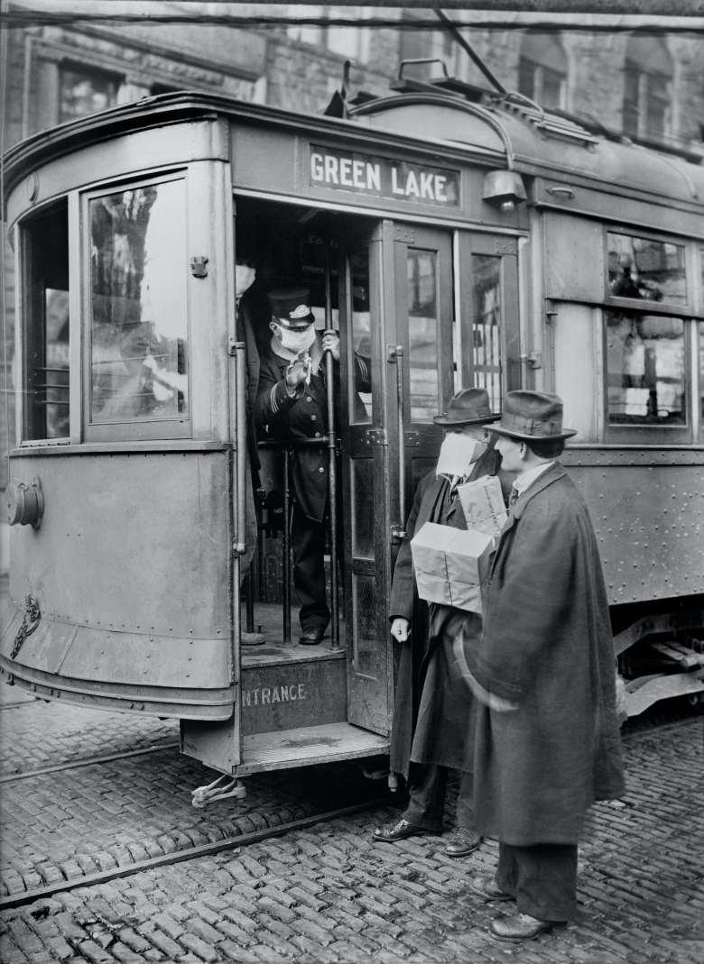 men with a streetcar