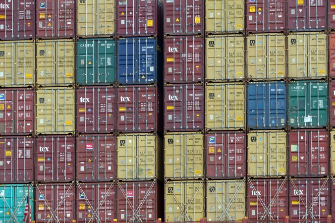 Stacks of shipping containers of various colors sit on an out-of-view ship at a port in Georgia