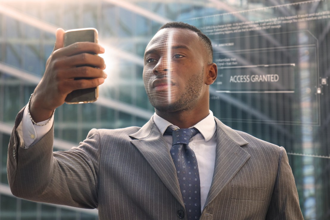 Image of a man looking into a phone.