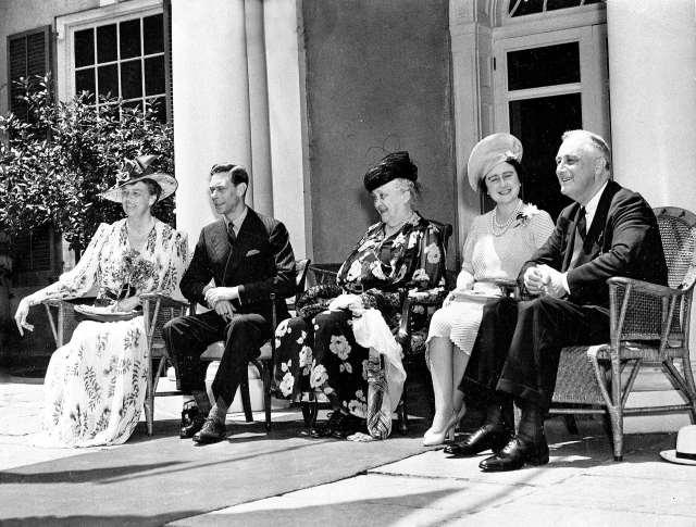 First lady Eleanor Roosevelt; King George VI; Sarah Delano Roosevelt, the president's mother; Queen Elizabeth; and President Franklin D. Roosevelt on the verandah of their family estate in Hyde Park.