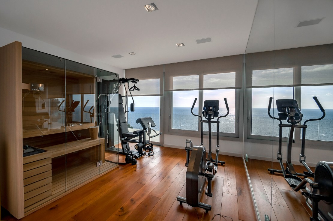 Sauna in a gym with sea view.