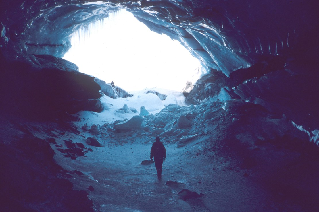 The author inside a giant icy chasm within a glacier.