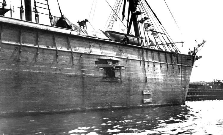 A black and white photo of a ship with a hole in it