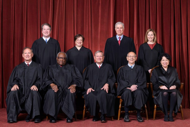 The nine members of the US Supreme Court in their robes led by Chief Justice John G. Roberts, Jr (front row, centre).: