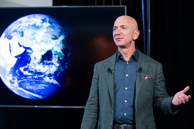 Jeff Bezos in front of an image of the Earth