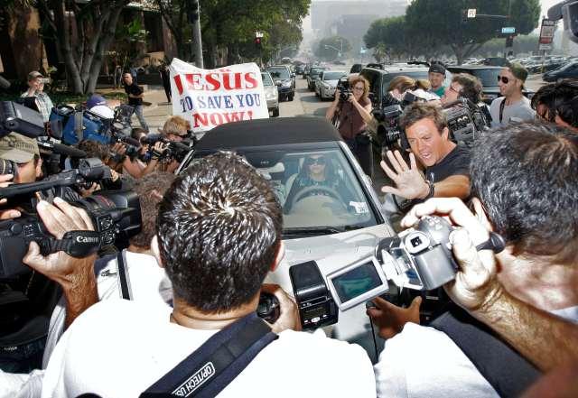 Paparazzi swarm Britney Spears' car.