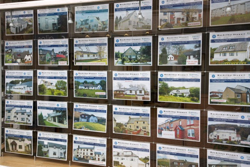 Houses for sale advertised in an estate agent's window