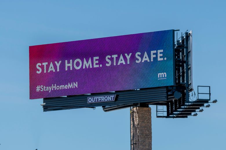 billboard with public health message 'Stay home, stay safe.'