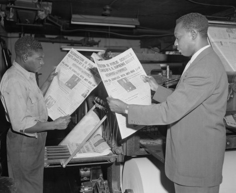 Black journalists read papers touting decision in Brown v. Board