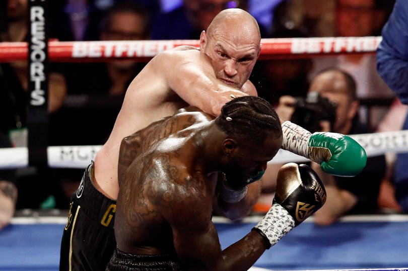 Tyson Fury throwing a punch at Deontay Wilder during a title fight in the US.