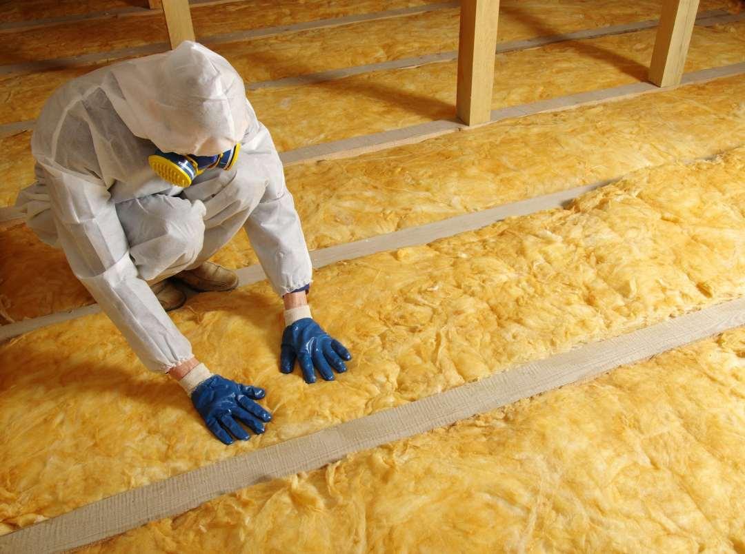 person installs insulation