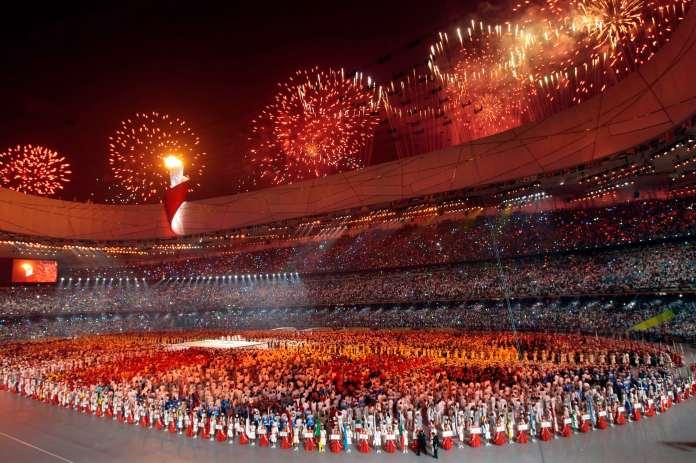 Fireworks explode over a stadium.