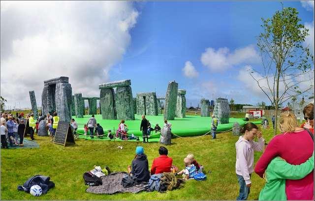 Punters jump on an inflatable Stonehenge art installation