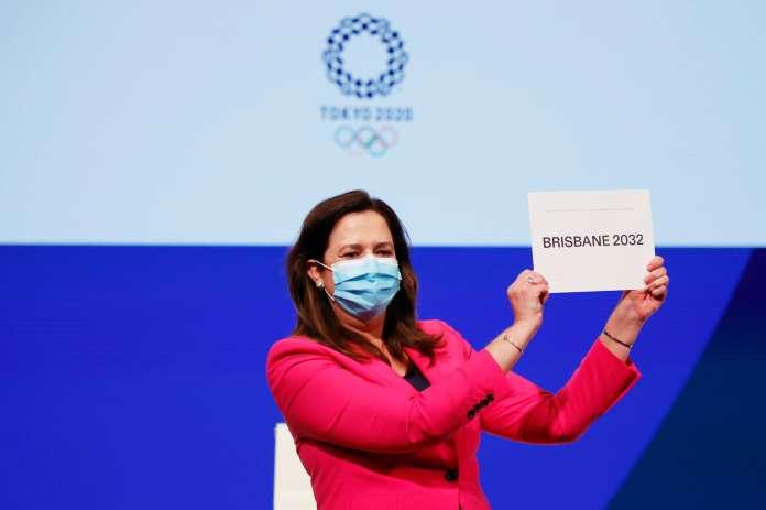 Women holding a sign written 'Brisbane 2032'