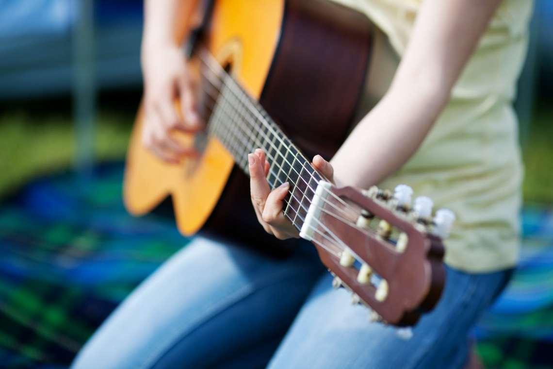 Girl playing guitar.