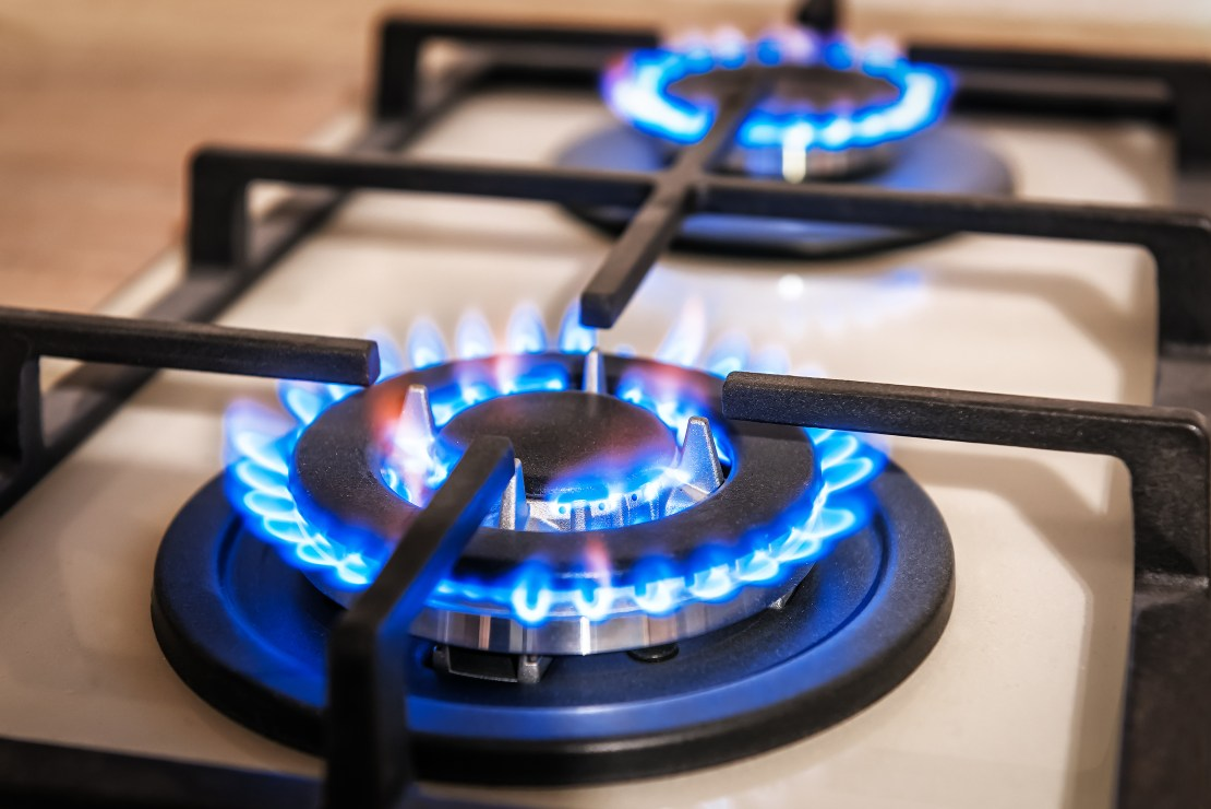 A lit gas stove.