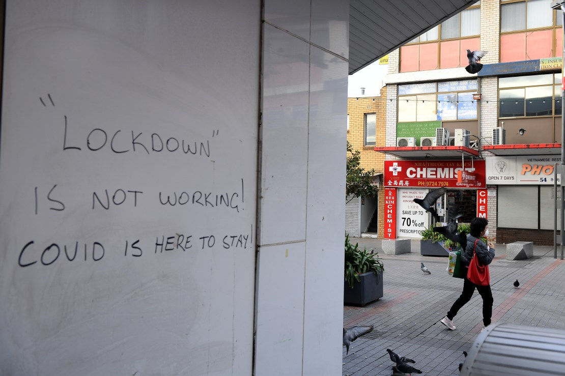 Graffiti that reads: 'Lockdown is not working! COVID is here to stay.'