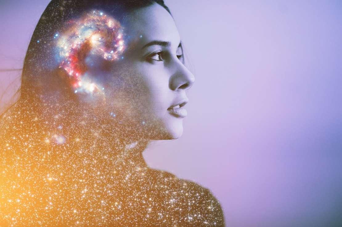 Brain, consciousness concept inside woman's head on purple background.