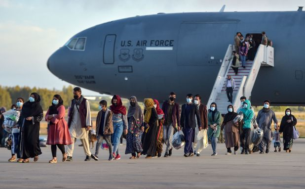 Afghan nationals disembark from a US air force aircraft after an evacuation flight from Kabul