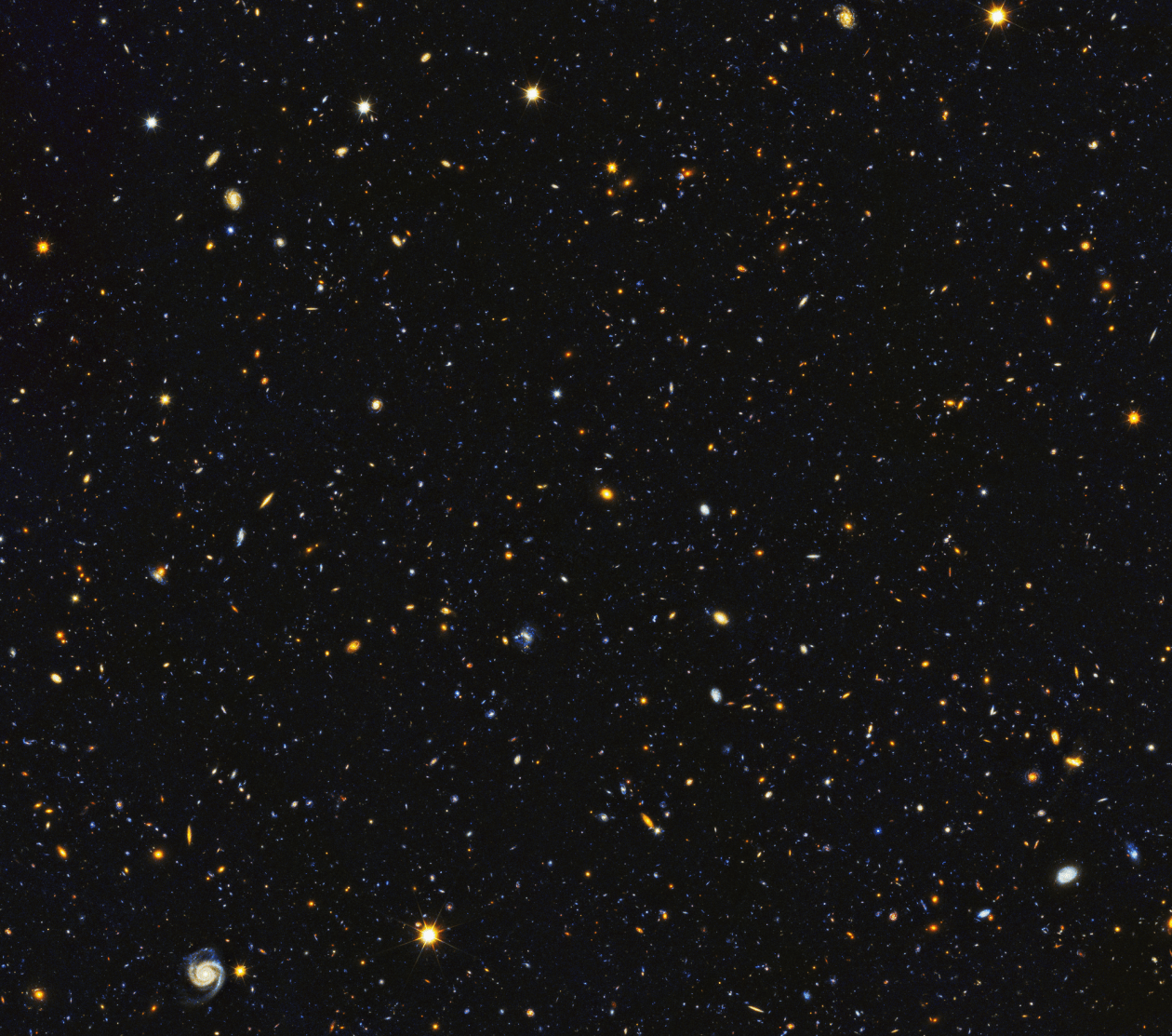 15,000 galaxies appear as small dots and blots in this NASA photograph of the nighttime sky.