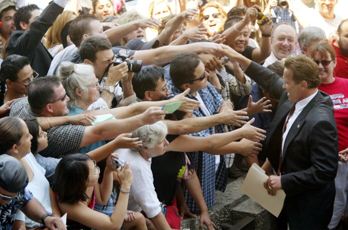 Arnold Schwarzenegger greets supporters during the 2003 California recall election.