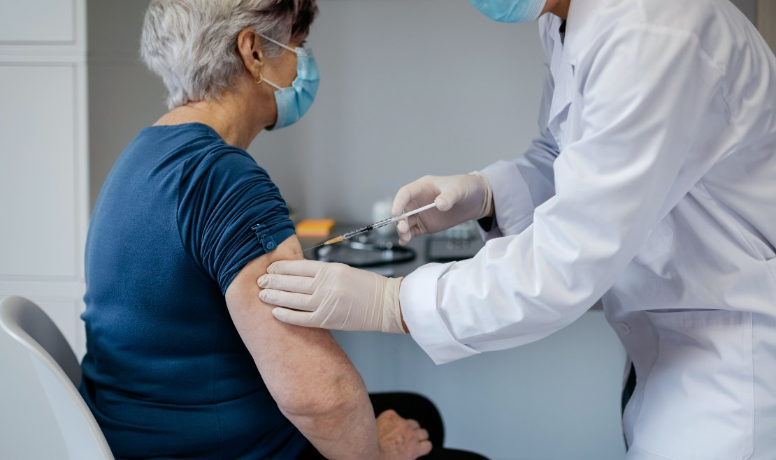 An older woman being vaccinated for COVID-19