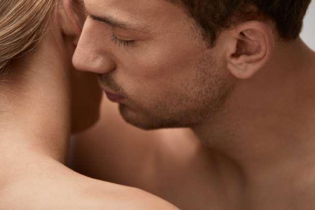A man smelling his girlfriend's hair
