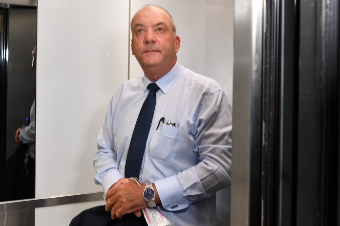 Former MP Daryl Maguire, with whom Berejiklian had ties, stands in an elevator at the Independent Commission Against Corruption.