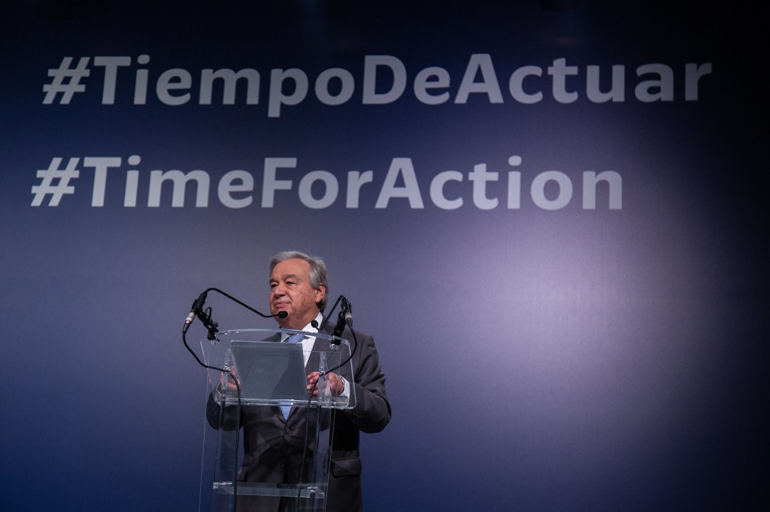 What is COP26? Here's how global climate negotiations work Guterres standing at a podium with #TimeForAction on the screen behind him